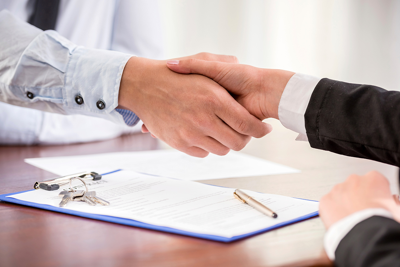shaking hands over a creative negotiation of new home price
