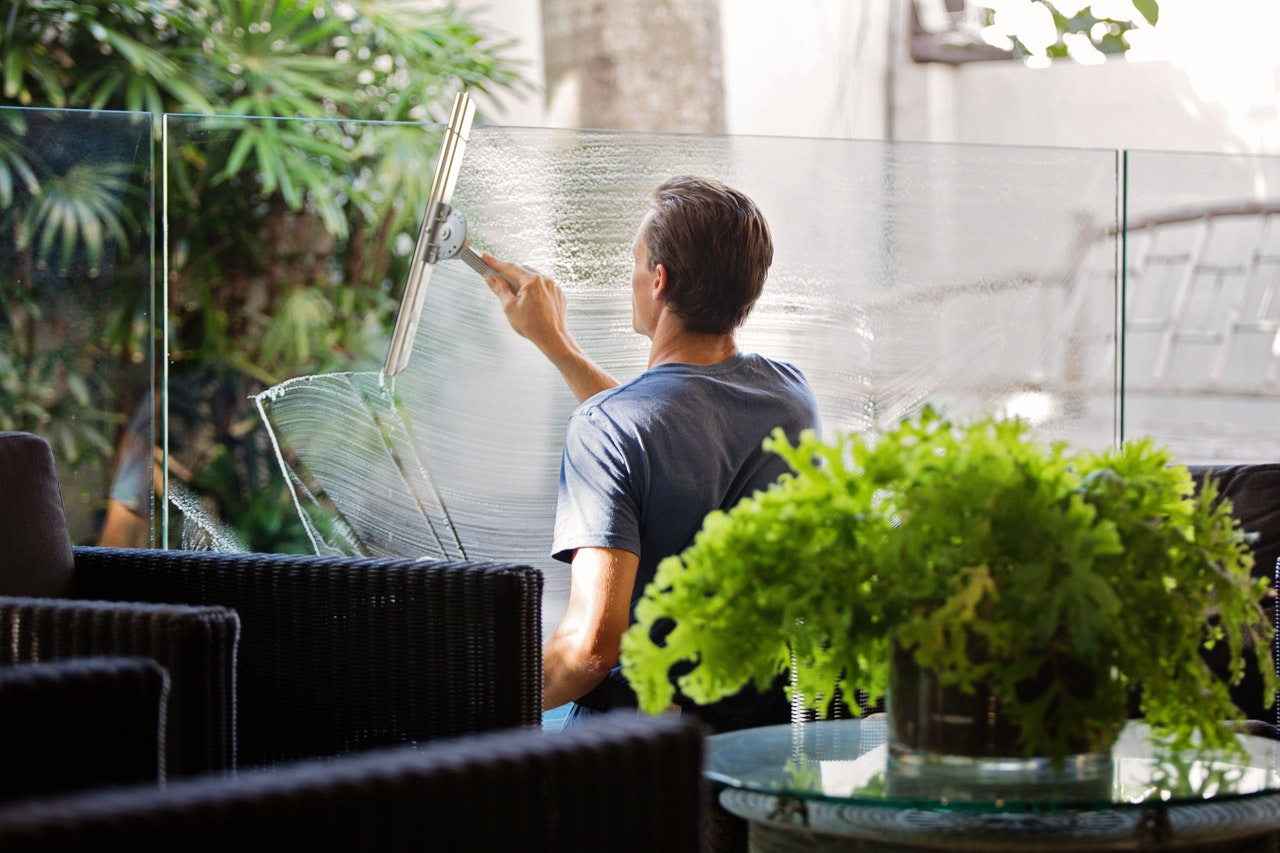 washing windows and squeegeeing dry