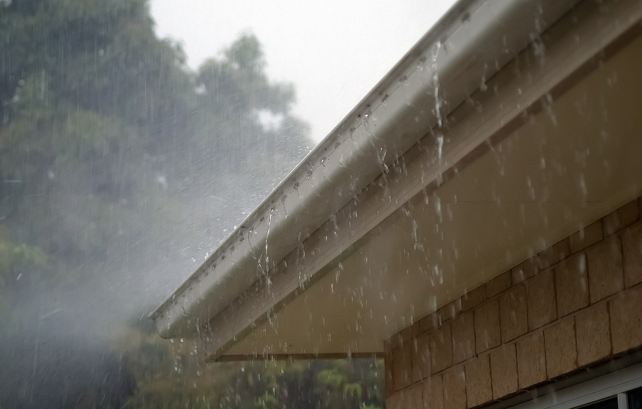 cleaning gutters before a storm