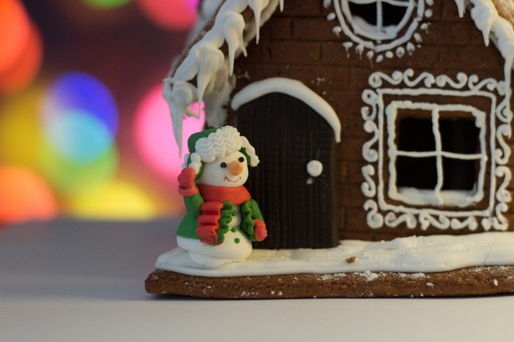 gingerbread house with marshmallow snowman