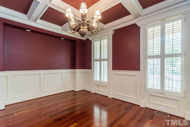 dining room with coffered ceilings